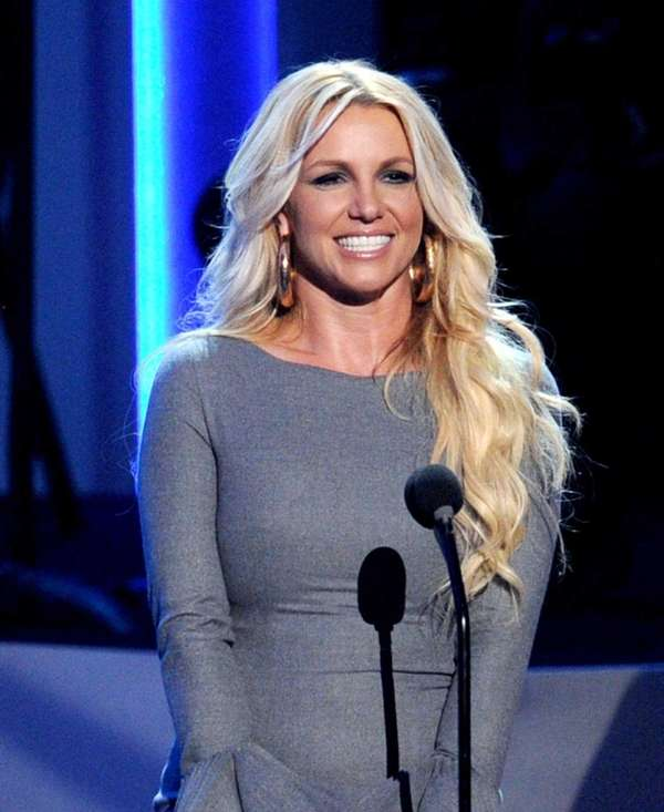 Singer Britney Spears speaks onstage at a taping