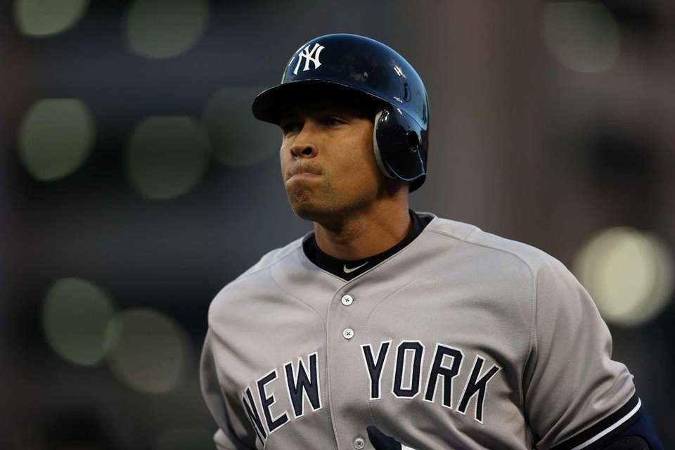 Alex Rodriguez reacts as he walks back to