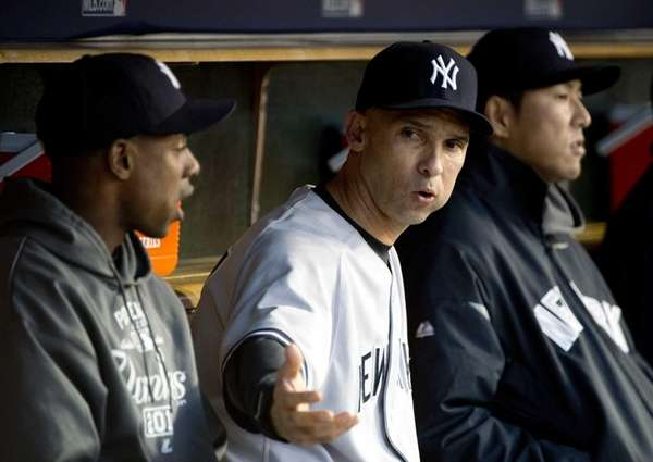 Raul Ibanez, center, talks with Curtis Granderson, left,