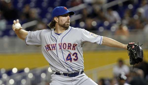 R.A. Dickey pitches to the Miami Marlins during