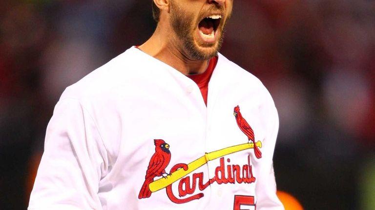 St. Louis Cardinals pitcher Adam Wainwright reacts after