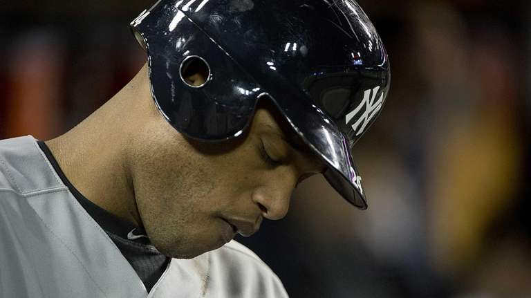 Robinson Cano looks down after an at-bat during