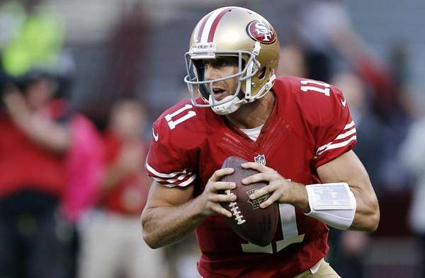San Francisco 49ers quarterback Alex Smith rolls out