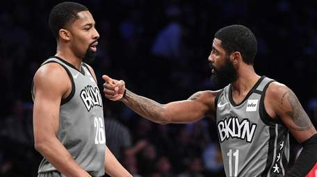 Nets guard Kyrie Irving talks to guard Spencer