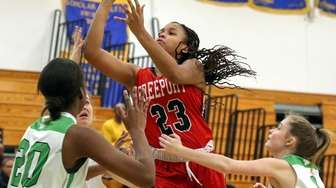 Taneece Wooden of Freeport takes the shot in