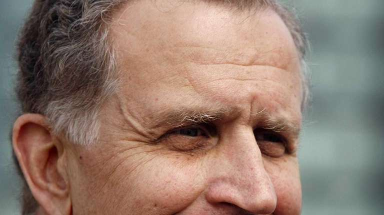Then-NFL commissioner Paul Tagliabue smiles during a press