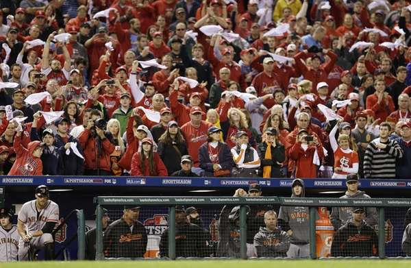 St. Louis Cardinals fans cheer during the ninth