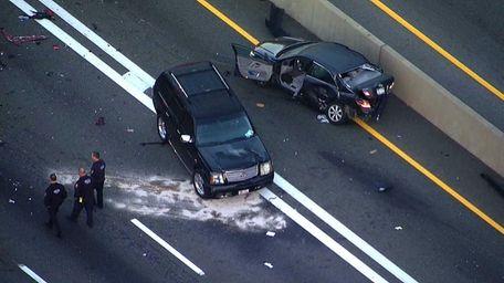 Police Investigators examine the scene of a multicar