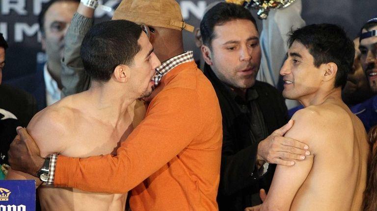 (L-R) Boxers Danny Garcia and Erik Morales exchange