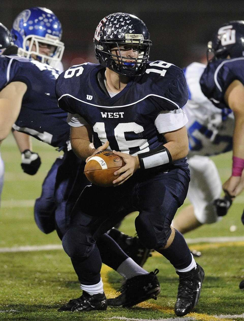 Smithtown West quarterback looks to hand off against