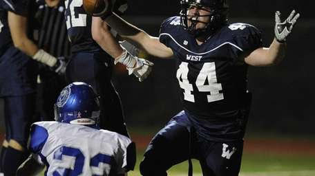 Smithtown West's Logan Greco reacts on the field