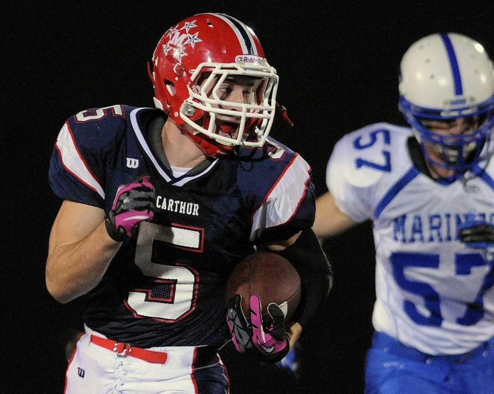 MacArthur running back Tom Kelleher rushes for a