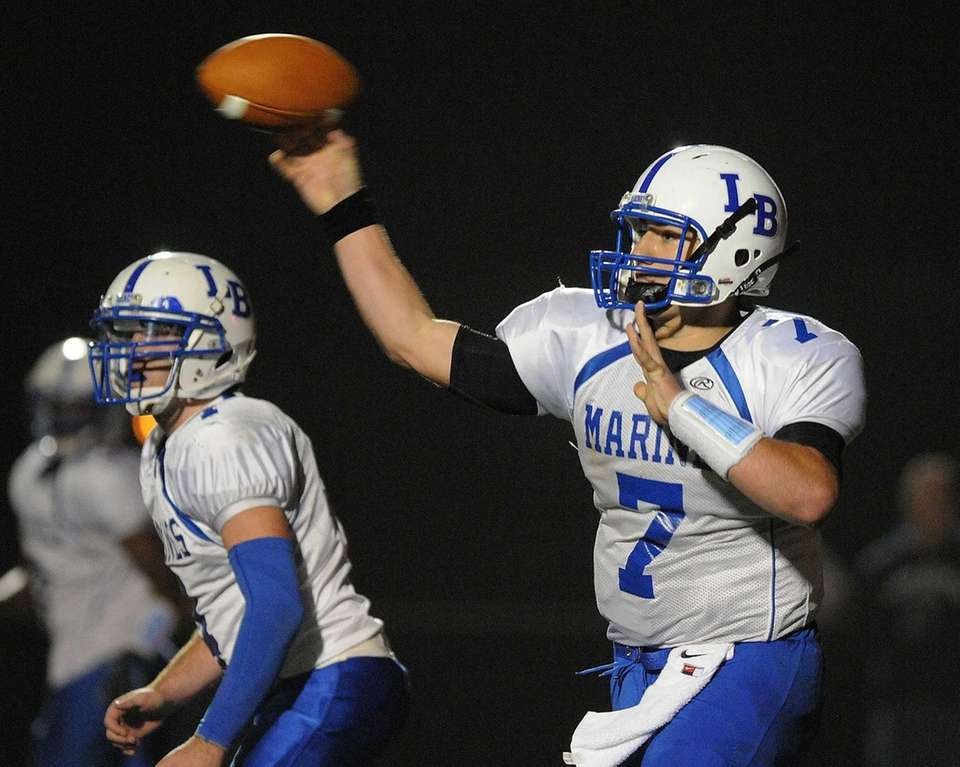 Long Beach quarterback Adam Salvadori throws a pass