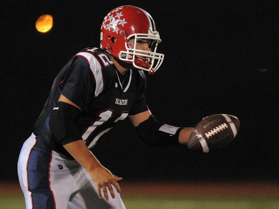 MacArthur quarterback Gerard Cunningham prepares to hand the