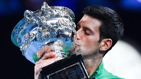 Serbia's Novak Djokovic kisses the Norman Brooks Challenge