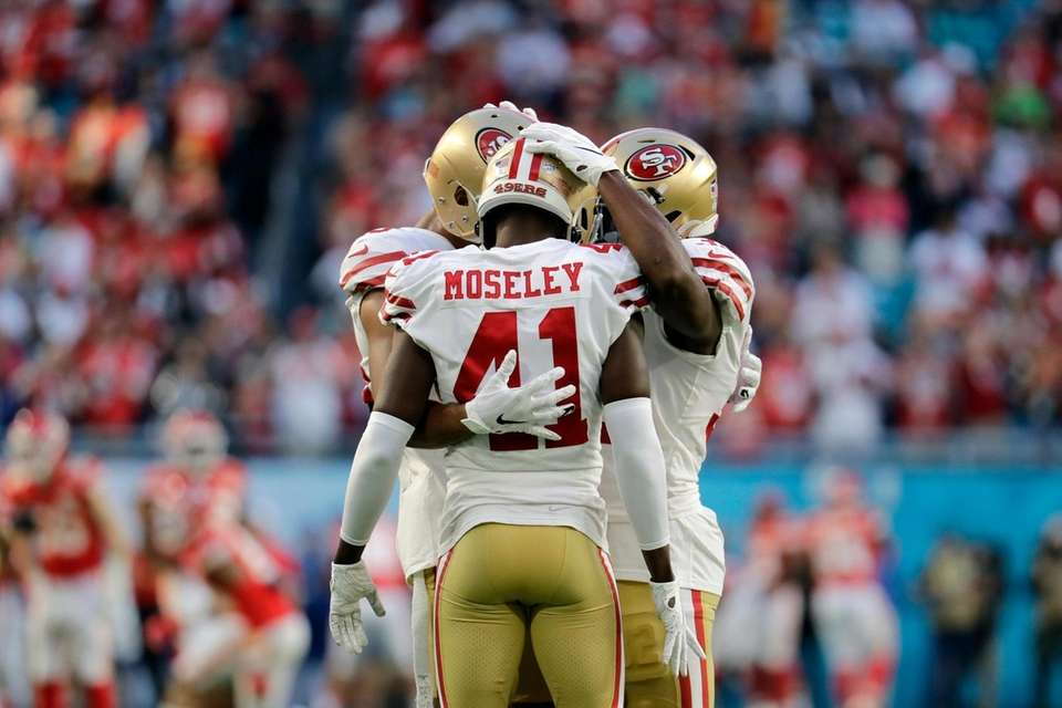 San Francisco 49ers' Ahkello Witherspoon, Emmanuel Moseley and