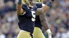 Notre Dame linebacker Manti Te'o celebrates after an