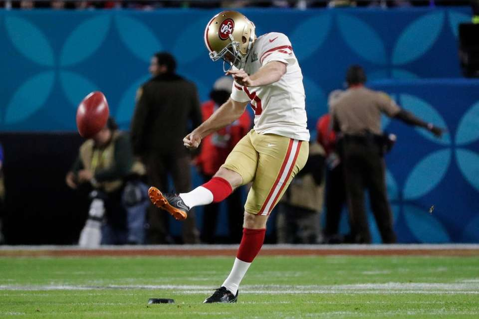 San Francisco 49ers' Mitch Wishnowsky kicks off against