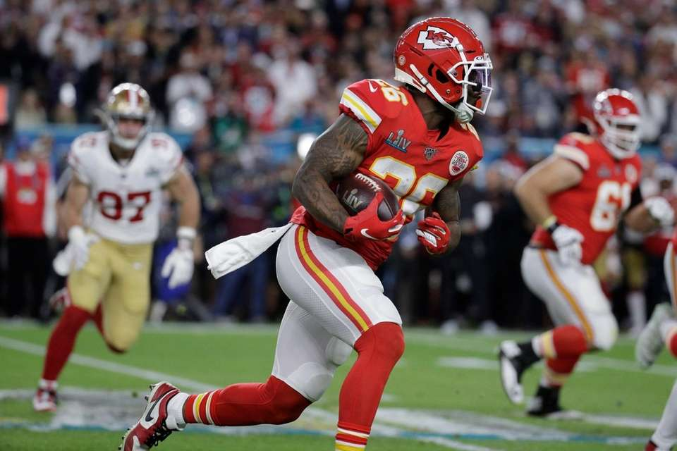Kansas City Chiefs' Damien Williams (26) runs against
