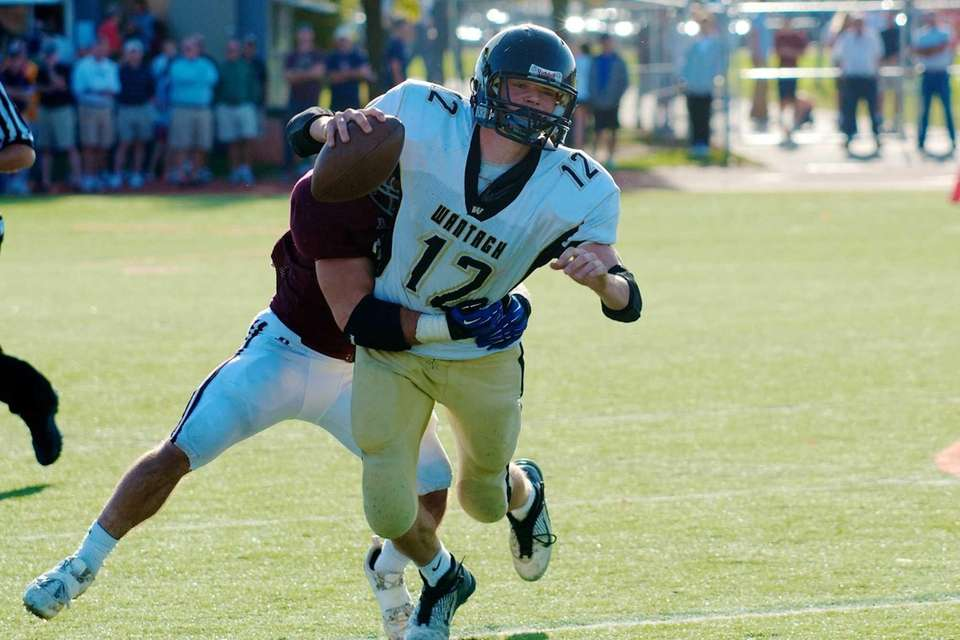 Wantagh quaterback back Gerard Roche is sacked by
