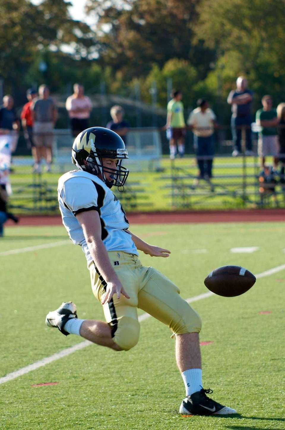 Wantagh Punter Michael O'Hara punts the ball off