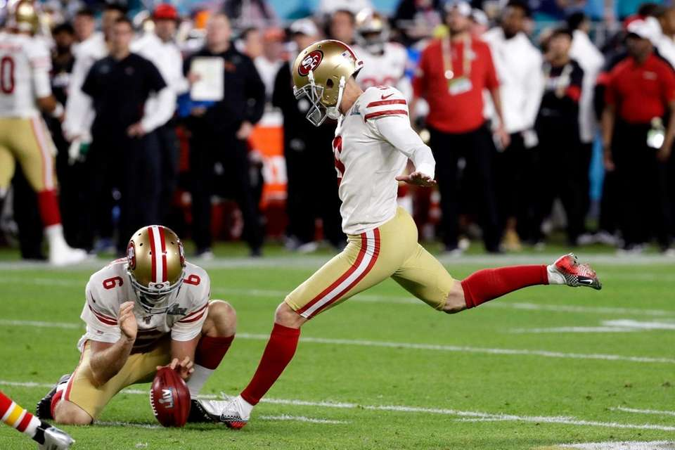 San Francisco 49ers' Robbie Gould, right, kicks a