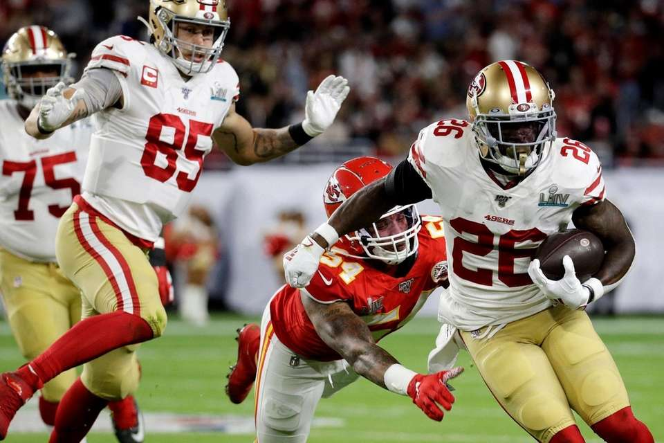 San Francisco 49ers' Tevin Coleman (26) runs against