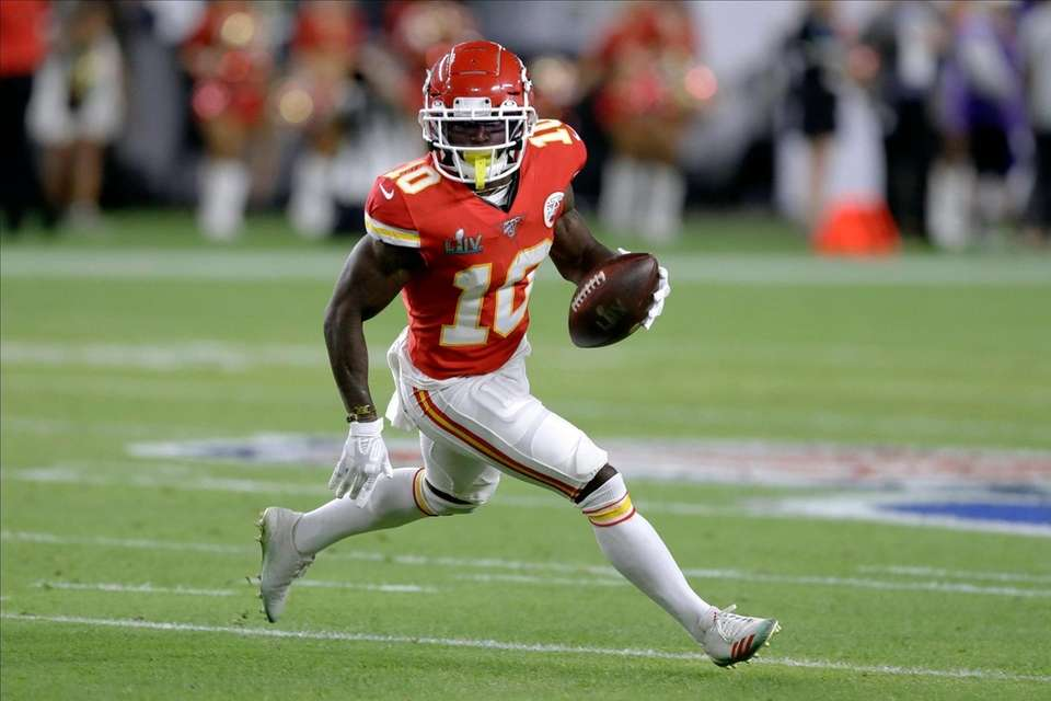 Kansas City Chiefs' Tyreek Hill runs against the