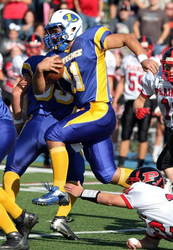 Lawrence's Joe Capobianco runs for some yardage during