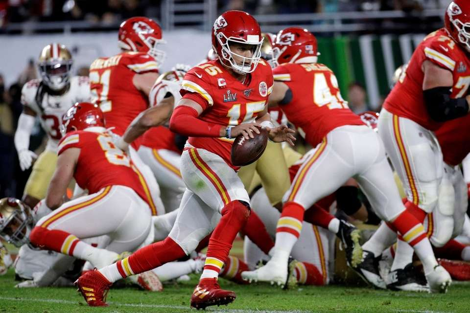 Kansas City Chiefs quarterback Patrick Mahomes (15) runs
