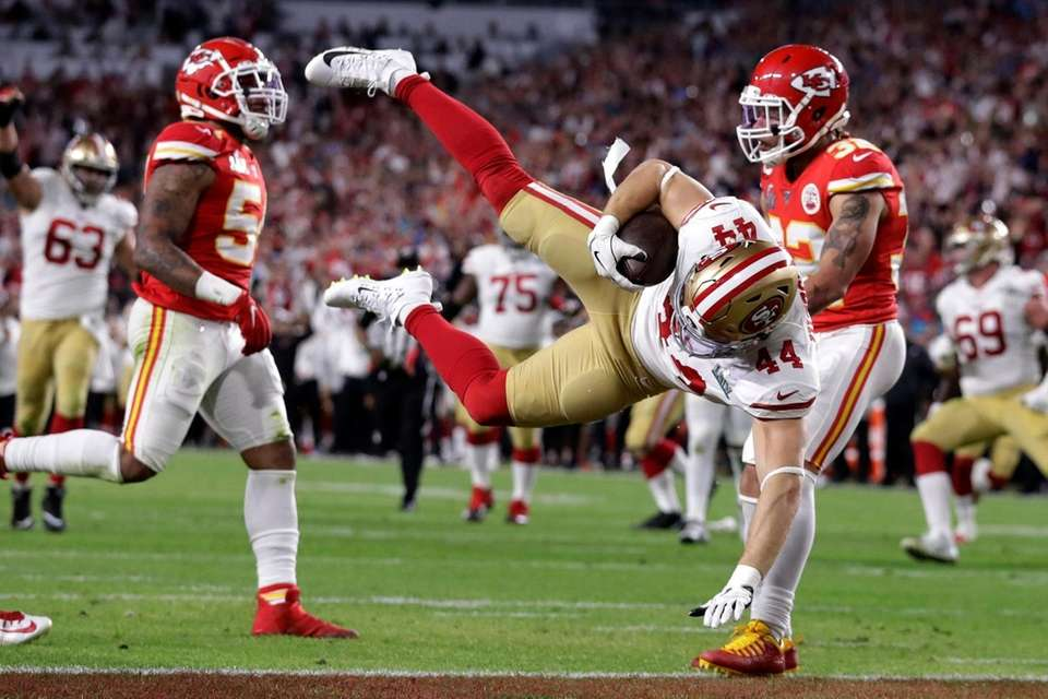 San Francisco 49ers' Kyle Juszczyk (44) falls into