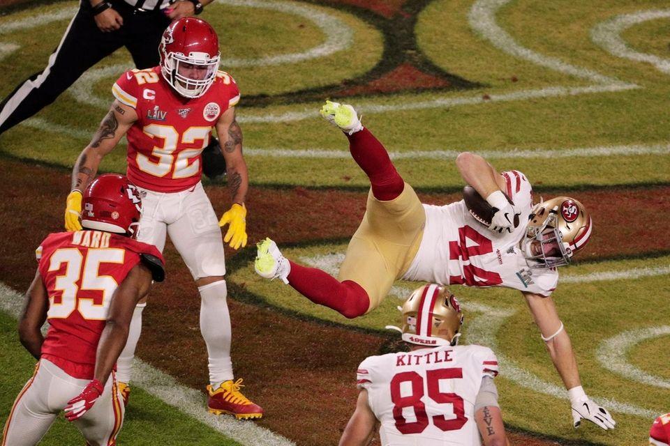 San Francisco 49ers' Kyle Juszczyk (44) scores a