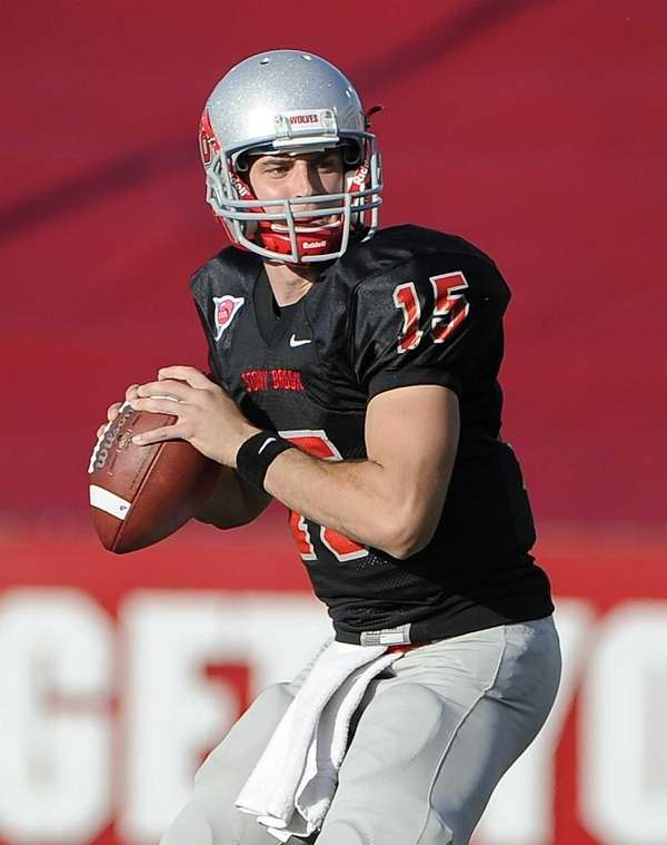 Stony Brook quarterback Kyle Essington looks to pass