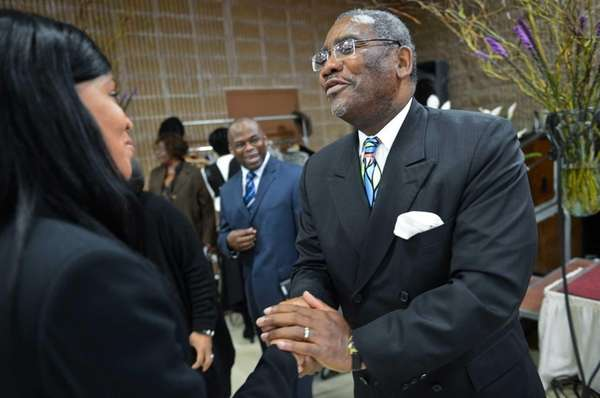 Rep. Gregory Meeks shakes hands with Nicole Robinson,