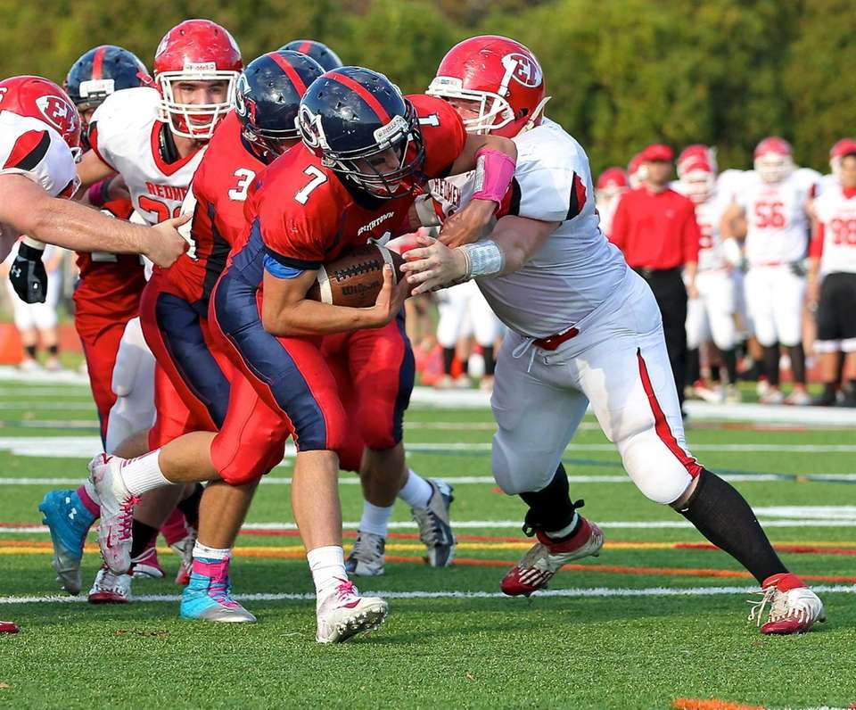 Smithtown East quarterback John Daniggelis powers through the