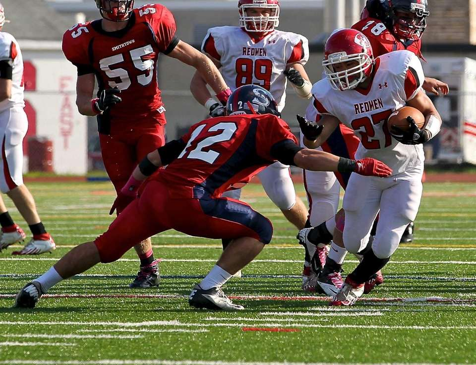 East Islip running back Andre Deegan tries to