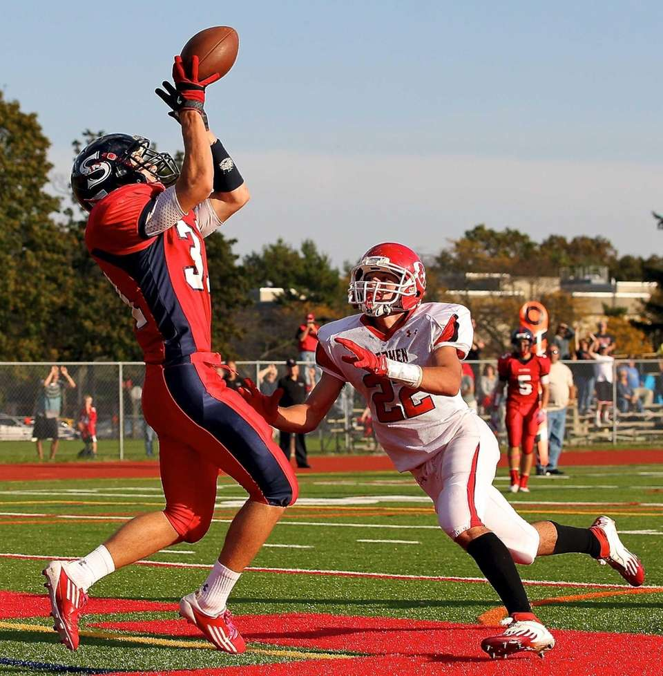 Smithtown East running back Andrew Federico grabs the