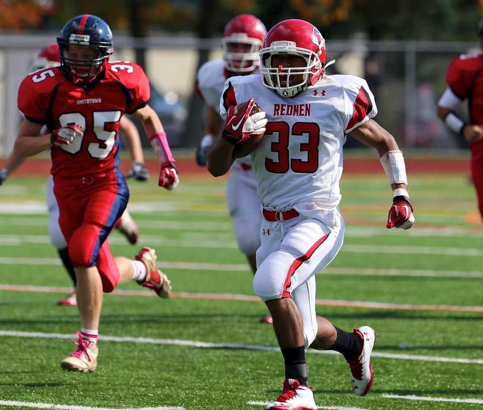 East Islip running back Erik Adon returns the