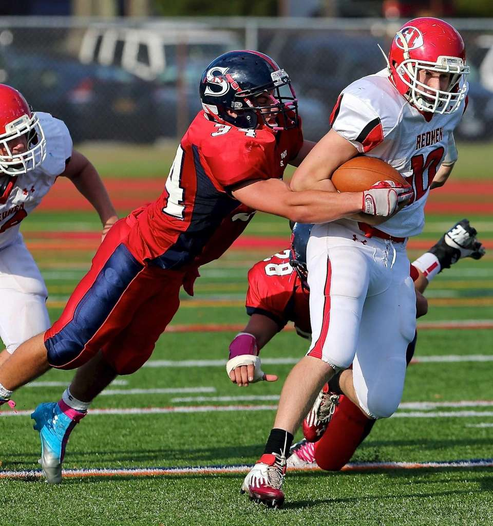 East Islip quarterback Casey Nolan moves the ball