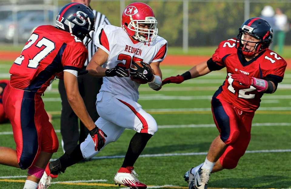 East Islip running back Andre Deegan goes between