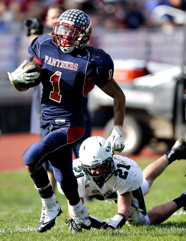 Miller Place running back Adin Greenfield breaks the