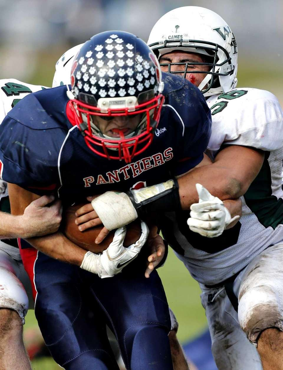 Miller Place running back Adin Greenfield drags two