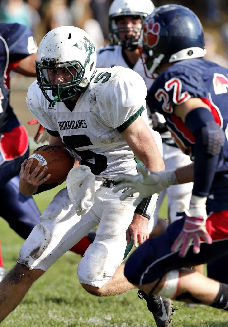 Westhampton quarterback Jack Murphy looks to avoid Miller