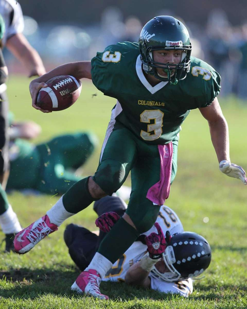 Floyd quarterback A.J. Otranto breaks a tackle by