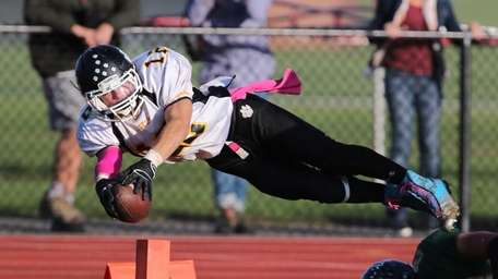 Northport running back Cody Swing dives for the