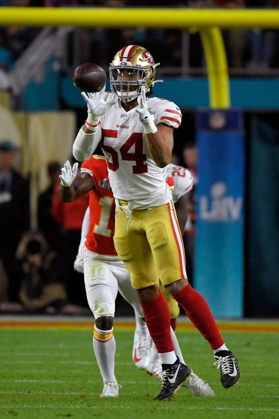 San Francisco 49ers' Fred Warner intercepts a pass