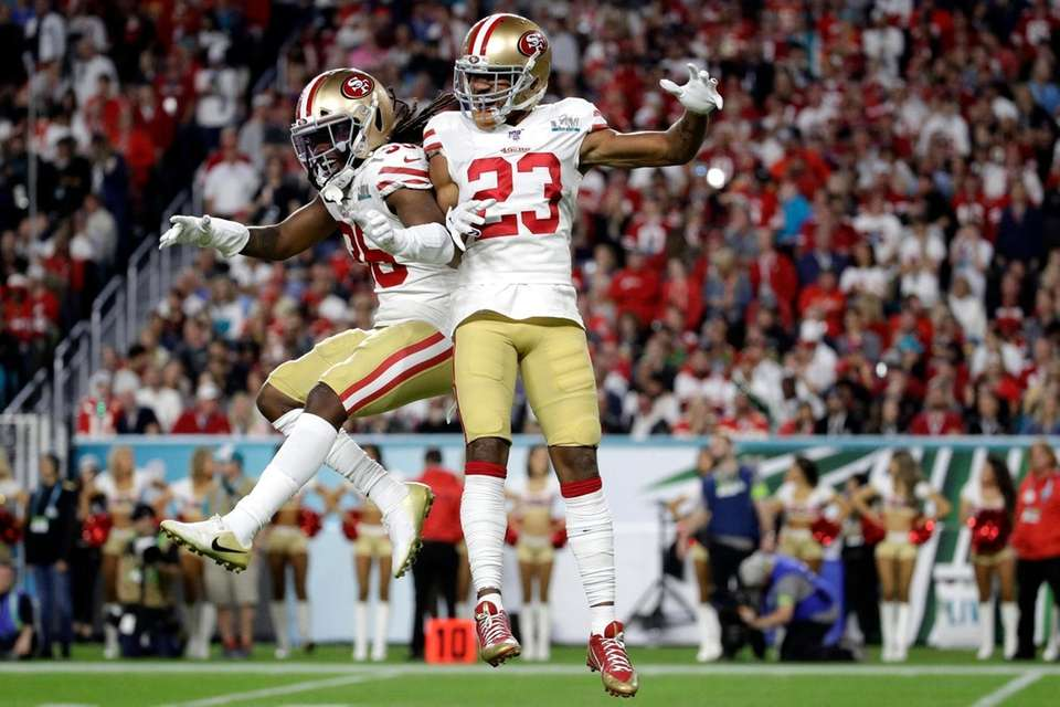 San Francisco 49ers' Marcell Harris, left, celebrates with
