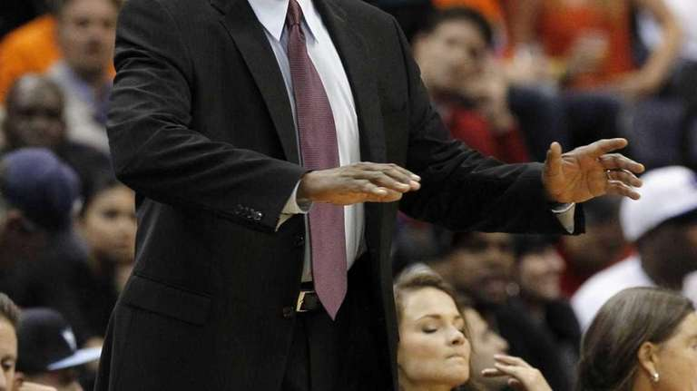 Mike Woodson calls to his players during the