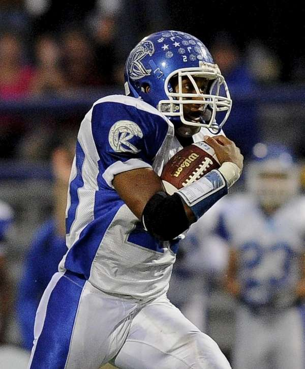 Riverhead's Jeremiah Cheatom carries the ball during a