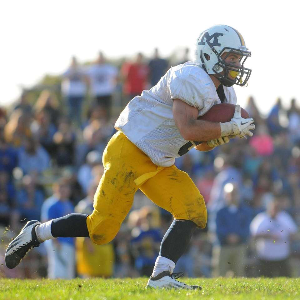 Massapequa running back Jack Korber rushes for a